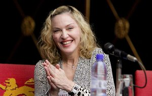In this Nov. 28, 2014 file photo, Madonna visits Malawian President Peter Mutharika at State House in Lillongwe  Malawi. In a surprise preview of her new album, Madonna released six songs Saturday, Dec. 20, 2014,  on iTunes and various streaming services.  The songs were released because several in-progress demos were leaked earlier this week, according to Madonna publicist Liz Rosenberg.