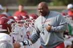 Arkansas assistant coach Clay Jennings speaks to players during practice Saturday, Dec. 13, 2014, at the university's practice facility in Fayetteville.