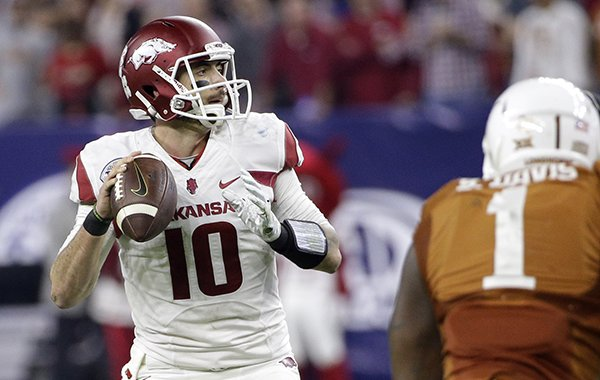 Arkansas quarterback Brandon Allen (10) throws a pass against Texas during the first half of the Texas Bowl NCAA college football game Monday, Dec. 29, 2014, in Houston. (AP Photo/David J. Phillip)