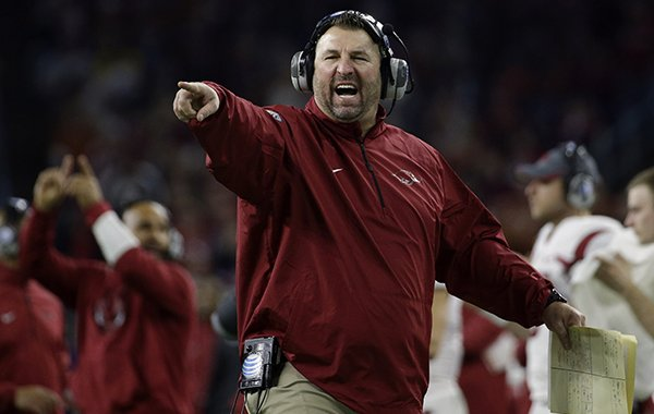 Arkansas coach Bret Bielema yells at the officials during the second half of the Texas Bowl NCAA college football game against Texas Monday, Dec. 29, 2014, in Houston. Arkansas won 31-7. (AP Photo/David J. Phillip)