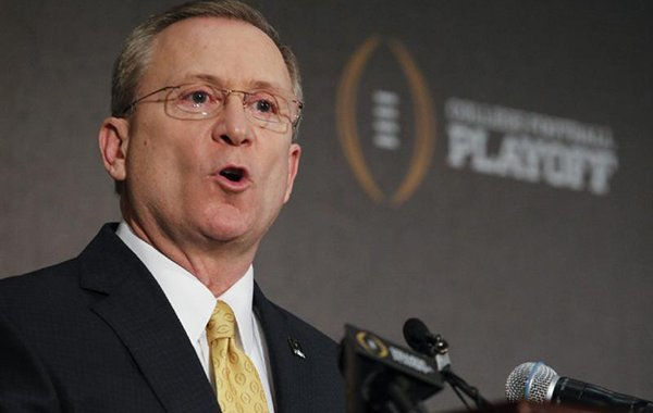 Jeff Long, College Football Playoff selections committee chairman, discusses the selection process of the semifinal pairings and semifinal bowl assignments during a news conference Sunday, Dec. 7, 2014, in Grapevine, Texas. (AP Photo/Tim Sharp)