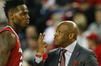 Arkansas head coach Mike Anderson talks with Arkansas forward Jacorey Williams (22) in the second half of an NCAA college basketball game against Georgia Tuesday, Jan. 6, 2015, in Athens, Ga. Arkansas won 79-75. (AP Photo/John Bazemore)