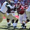 Arkansas defensive tackle Darius Philon (center), a redshirt sophomore, said Tuesday he has decided ...