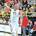 Malik Monk, Bentonville junior, goes up for a dunk Tuesday against Fort Smith Northside on at Benton...