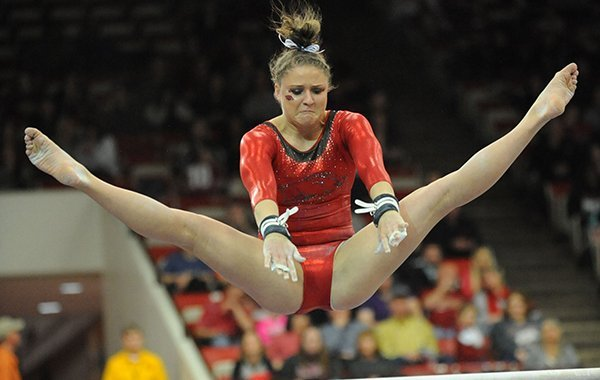Amanda Wellick of Arkansas competes in the bars portion of the Razorbacks' meet with Alabama Friday, Jan. 16, 2015, in Barnhill Arena in Fayetteville.