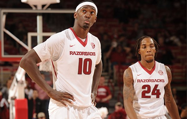 Bobby Portis (10) and Michael Qualls of Arkansas react during the final minute against Mississippi during the second half of play Saturday, Jan. 17, 2015, in Bud Walton Arena in Fayetteville.
