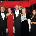 Asa Hutchinson III, from left, Dave and Sarah Wengel, Gov. Asa Hutchinson and wife Susan and Nubia a...