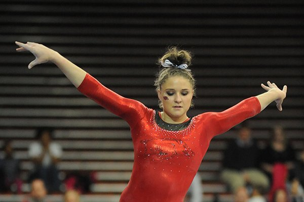 Amanda Wellick of Arkansas competes in the beam portion of the Razorbacks' meet with Alabama Friday, Jan. 16, 2015, in Barnhill Arena in Fayetteville.