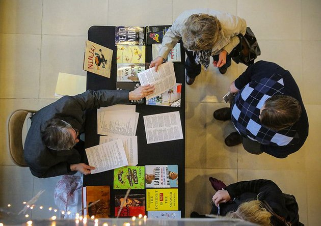 1222015-arkansas-democrat-gazettestephen-b-thornton-arkansas-literary-festival-director-brad-mooy-left-passes-out-information-on-festival-authors-to-cathy-spivey-top-right-michael-taggard-and-jennifer-willis-bottom-right-after-a-presentation-announcing-upcoming-central-arkansas-library-systems-events-thursday-at-the-ron-robinson-theater-in-little-rock-cals-announced-some-of-the-more-than-80-presenters-to-be-featured-at-the-twelfth-annual-arkansas-literary-festival-april-23-26-2015-they-also-announced-arkansas-sounds-monthly-concert-series-and-film-series-lineups-for-the-ron-robinson-theater-and-other-library-programs