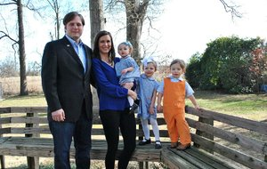 """Arkansas Democrat-Gazette/BRIAN FANNEY - 01/21/2015  - Nathan and Kristin Reed stand with their three children, 1-year-old Katherine and 2-year-old twins Jane-Anne and Stanley """"Eldon,"""" behind their home in Marianna."""