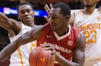 Arkansas' Alandise Harris (2) can't find an opening as he is guarded by Tennessee's Willie Carmichael III (24) and Drek Reese (23) in the second half of an NCAA college basketball game Tuesday, Jan. 13, 2015, in Knoxville, Tenn. (AP Photo/Patrick Murphy-Racey)