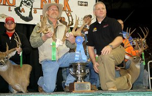 Arkansas Democrat-Gazette/BRYAN HENDRICKS Don Kittler won the 25th annual Arkansas Big Buck Classic Sunday with the rack of a whitetailed deer he killed in Prairie County that scored 207 7/8 Boone and Crockett. His buck was the biggest of six that qualified for the Boone and Crockett All-Time Awards book. (Lev Bradford of Bradford Marine and ATV is the guy in the black shirt).