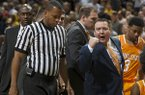 Tennessee coach Donnie Tyndall, right, argues a call with a referee during a timeout in the second half of an NCAA college basketball game against Missouri on Saturday, Jan. 17, 2015, in Columbia, Mo. Tennessee won 59-51. (AP Photo/L.G. Patterson)