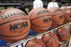 In this file photo, Wilson basketballs sit in a rack before an NCAA college basketball tournament first round game. (AP Photo/Phil Coale)