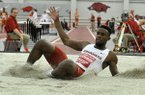 Arkansas' Jarrion Lawson jumps during a meet against Texas on Friday, Jan. 16, 2015 at Randal Tyson Track Center in Fayetteville.