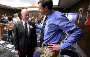 Greg Adams (left), president of the Little Rock School Board, talks with state Board of Education Chairman Sam Ledbetter after the board's vote Wednesday to take over the district and remove the board immediately. Ledbetter cast the deciding vote for the takeover.
