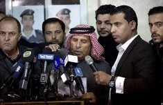 Safi al-Kaseasbeh (center), ...