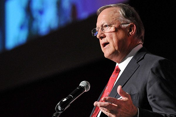 Former Arkansas quarterback Bill Montgomery speaks during the 'Coach's Quarter: A Celebration of Coach Broyles' Life and Career' banquet at the John Q Hammons Center in Rogers on Saturday, June 7, 2014.