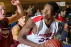 S.K. Shittu with Providence Academy works his way to the basket against Muldrow on Thursday, Nov. 13, 2014, in Rogers.