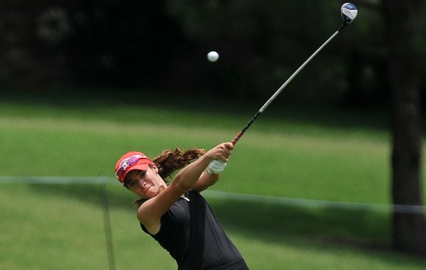 University of Arkansas golfer Gaby Lopez takes a shot on the fairway of hole No. 14 during the Walmart NW Arkansas Championship on Sunday, June, 29, 2014 at Pinnacle Country Club in Rogers.