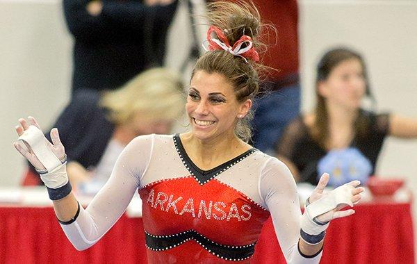 Arkansas freshman Paige Zaziski celebrates after her routine on the bars on Friday, Feb. 6, 2015, during the Razorbacks' meet against Florida inside Barnhill Arena in Fayetteville.