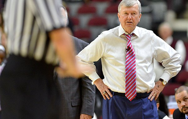 Texas A&M coach Gary Blair waits as referees discuss a foul call against the team, during a timeout in the first half of an NCAA college basketball game against Arkansas on Thursday, Feb. 12, 2015, in College Station, Texas. Texas A&M won 59-55. (AP Photo/The Bryan-College Station Eagle, Sam Craft)
