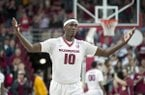 Arkansas forward Bobby Portis, center, celebrates after a Missouri turnover during the first half of an NCAA college basketball game on Wednesday, Feb. 18, 2015, in Fayetteville, Ark. (AP Photo/Gareth Patterson)