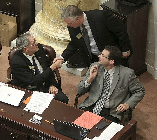 state-rep-jack-ladyman-r-jonesboro-left-is-congratulated-thursday-by-rep-donnie-copeland-d-north-little-rock-after-ladymans-legislation-on-water-fluoridation-passed-the-house-state-rep-stephen-meeks-r-greenbrier-right-also-backed-the-bill-which-lets-local-water-systems-instead-of-the-state-decide-whether-to-add-fluoride