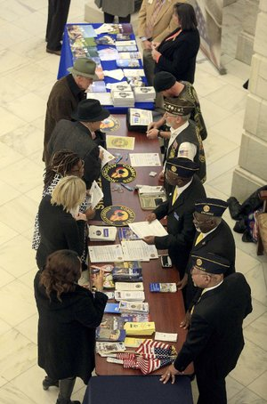 Representatives of various veterans organizations talk with veterans Thursday in the state Capitol rotunda as part of veterans service organizations day.