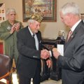 """U.S. Rep. Steve Womack presents a bronze version of the Congressional Gold Medal to Manford """"Manny"""" ..."""