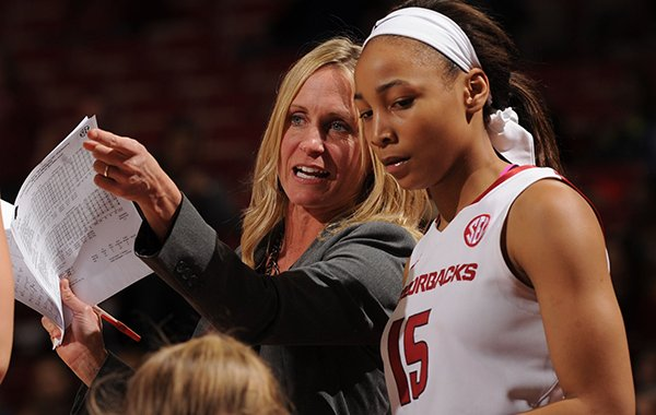 Arkansas assistant coach Christy Smith speaks with Kelsey Brooks (15) against Missouri during the second half Saturday, Jan. 17, 2015, in Bud Walton Arena in Fayetteville.