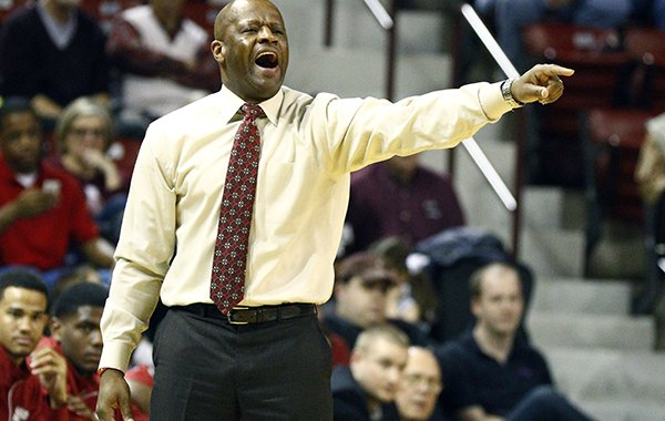 Arkansas basketball coach Mike Anderson calls out to his players in the second half at an NCAA college basketball game against Mississippi State in Starkville, Miss., Saturday, Feb. 21, 2015. No. 18 Arkansas won 65-61. (AP Photo/Rogelio V. Solis)