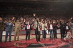 Former Arkansas head coach Nolan Richardson calls the hogs during halftime after receiving a replica of his banner Tuesday, Feb. 24, 2015, at Bud Walton Arena in Fayetteville.