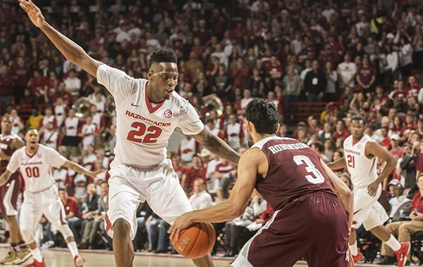 Arkansas forward Jacorey Williams defends Texas A&M guard Alex Robinson in the first half Tuesday, Feb. 24, 2015, at Bud Walton Arena in Fayetteville.