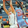 Giesen (left) and Bishop battle for a rebound Thursday in Rogers.