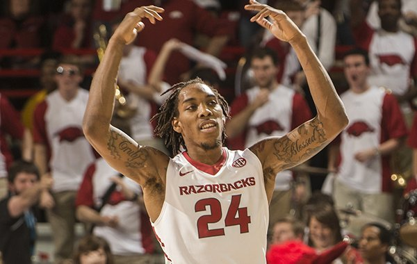 Arkansas junior Michael Qualls gets pumped up against Texas A&M in the first half Tuesday, Feb. 24, 2015 at Bud Walton Arena in Fayetteville.