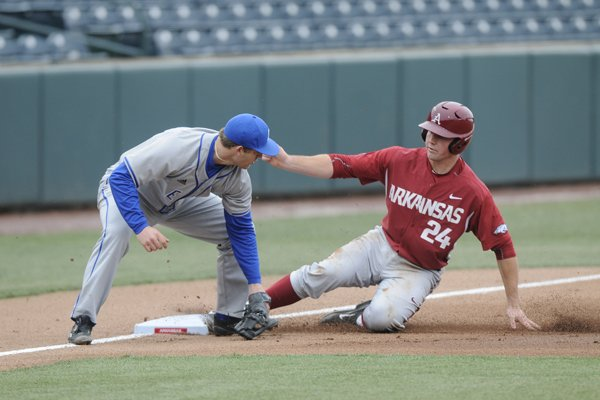 Arkansas' Chad Spanberger beats the throw to Eastern Illinois third baseman Brant Valach Monday, March 2, 2015.
