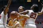 Tennessee center Isabelle Harrison (20) gets tied up by Mississippi guard Shandricka Sessom (23) during the first half of an NCAA college basketball game in Oxford, Miss., Thursday, Feb. 12, 2015. (AP Photo/Rogelio V. Solis)
