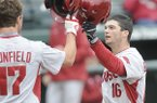 Arkansas' Andrew Benintendi (16) celebrates a fifth inning home run with Luke Bonfield during a game against Eastern Illinois on Tuesday March 3, 2015, at Baum Stadium in Fayetteville.