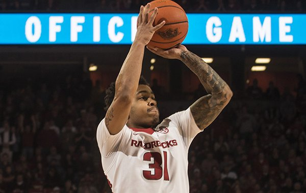 Arkansas guard Anton Beard attempts a shot during a game against Texas A&M on Tuesday, Feb. 24, 2015, at Bud Walton Arena in Fayetteville.