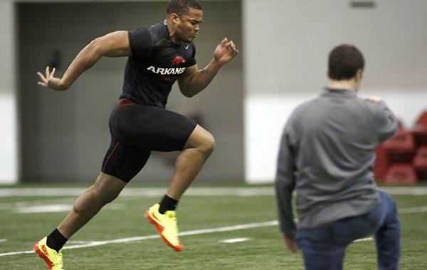Arkansas defensive end Trey Flowers runs during the program's pro day on Wednesday, March 4, 2015, at Walker Indoor Pavilion in Fayetteville.