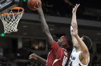 Arkansas' Bobby Portis (10) drives to the basket in front of South Carolina's Michael Carrera (24) iduringthe first half of an NCAA college basketball game, Thursday, March 5, 2015, in Columbia, S.C. (AP Photo/Travis Bell)