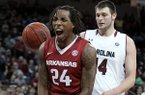 Arkansas' Michael Qualls (24) celebrates after scoring, in front of South Carolina's Michael Carrera, right, and Laimonas Chatkevicius during the second half of an NCAA college basketball game, Thursday, March 5, 2015, in Columbia, S.C. Arkansas won 78-74. (AP Photo/Travis Bell)