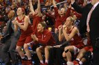 Arkansas' Melissa Wolff (from left), Katie Powell and Joey Bailey celebrate in the closing minutes of their victory over Ole Miss' during the SEC Women's tournament at Verizon Arena in North Little Rock on Thursday, March 5, 2015.