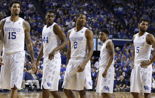 Kentucky players, from left, Willie Cauley-Stein, Dakari Johnson, Aaron Harrison, Tyler Ulis and Andrew Harrison re-enter the game during the second half of an NCAA college basketball game against Florida, Saturday, March 7, 2015, in Lexington, Ky. Kentucky won 67-50. (AP Photo/James Crisp)
