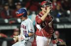 Catcher Tucker Pennell (right) of Arkansas watches as Tyler Frost of Gonzaga scores during the seventh inning Tuesday, March 10, 2015, at Baum Stadium in Fayetteville.
