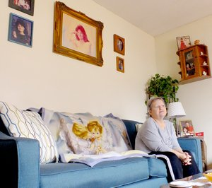Brandon Howard/The Weekly Vista Georgia Stidham keeps her home in Gravette lined with photos of her late daughter, Dana. Georgia said she thought the murder case would take one year to solve. Now after 26 years of waiting, she still hopes Dana's killer will be caught.