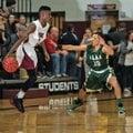 Pine Bluff's Brandon Little (left) looks to drive toward the basket against Alma's Braylon Parker du...