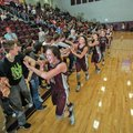 Siloam Springs' Baily Cameron and her teammates celebrate with fans Tuesday after the Lady Panthers ...