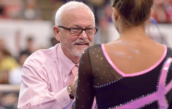 Arkansas gymnastics coach Mark Cook congratulates Paige Zaziski during a meet against Missouri on Friday, Feb. 27, 2015, at Barnhill Arena in Fayetteville.